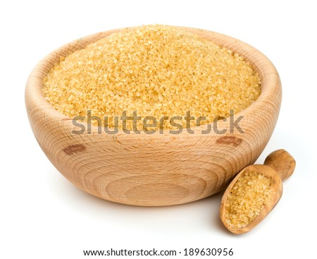 brown sugar in a wooden bowl isolated on white