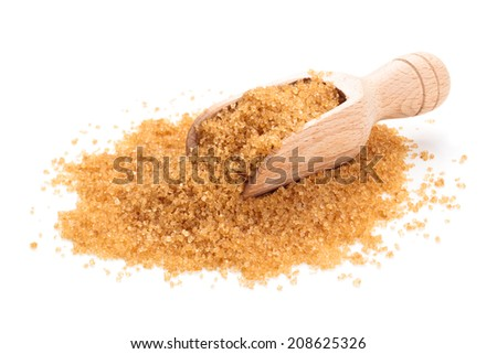 Brown sugar in scoop. Isolated on white. - stock photo