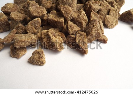 brown sugar lump on white background