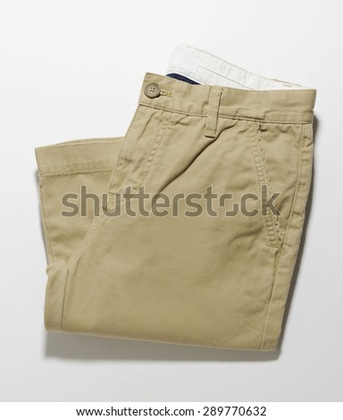 brown summer trouser isolated with shadows - stock photo