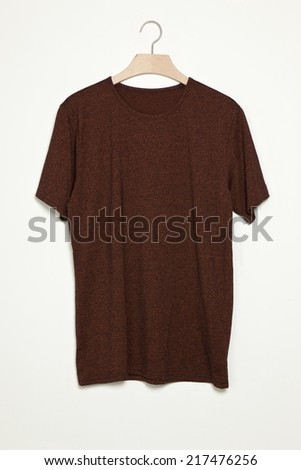 Brown t-shirts with wood hanger isolated white. - stock photo