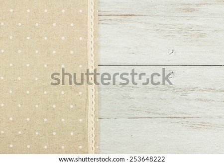 brown tablecloth on white wooden table. - stock photo