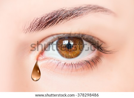 Brown tears in eyes of crying girl - stock photo