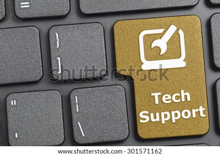 Brown tech support key on keyboard - stock photo