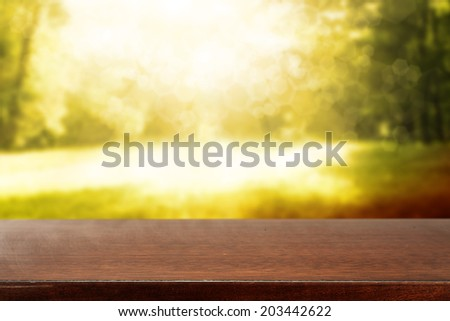 brown top in summer garden with sun light  - stock photo