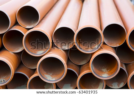 Brown tubes waiting to be used. - stock photo