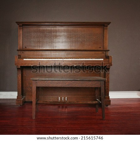 brown upright piano in a living room - stock photo