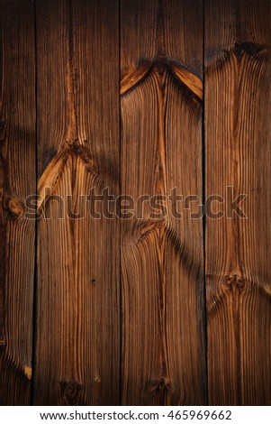 Brown vintage old wooden panel texture background with vertical unpainted aged planks and gaps and darker shaded border