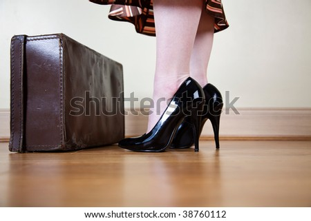 Brown vintage suitcases and black stilettos