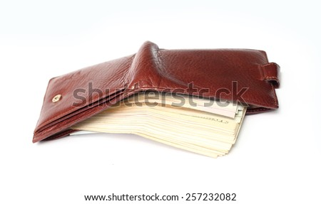 brown wallet with money - stock photo