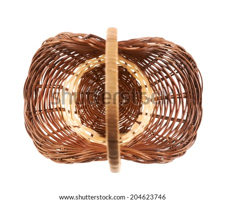 Brown wicker basket isolated over the white background, top view above - stock photo