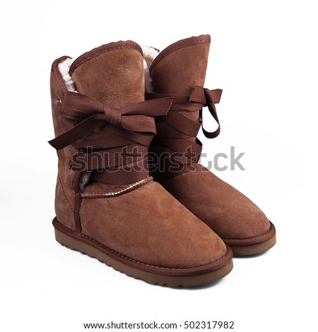 brown winter boots over white