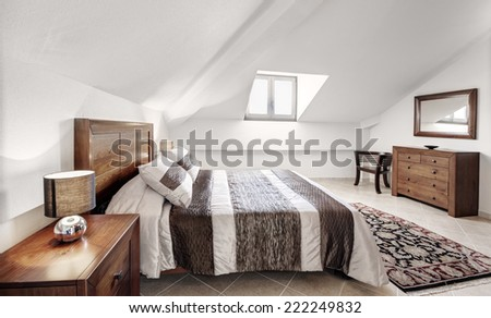 brown wood bedroom with view - stock photo