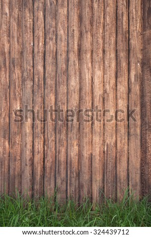brown wood fence background with green grass