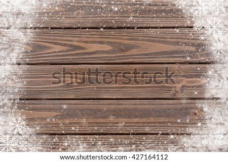 Brown wooden background with snow effect - stock photo