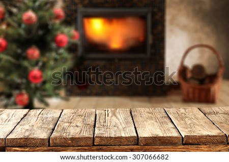 brown wooden desk space and xmas tree  - stock photo