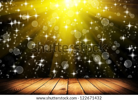 Brown wooden floor with natural patterns and flying stars. Christmas background