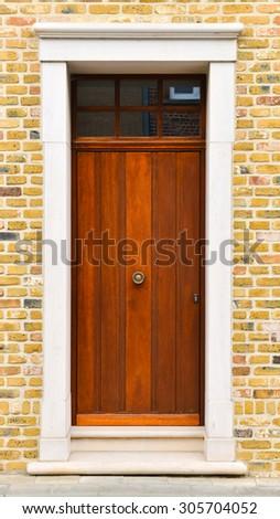 Brown wooden front door - stock photo