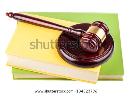 Brown wooden gavel and books isolated on white background - stock photo