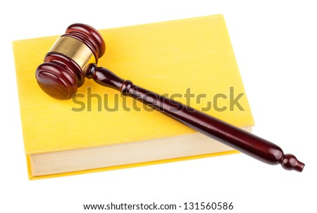 Brown wooden gavel and yellow book isolated on white background - stock photo