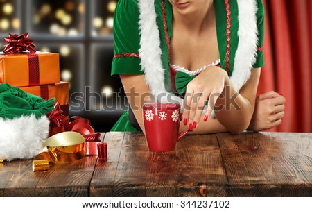 brown wooden table and elg and red mug and box  - stock photo