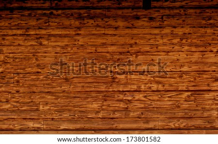 brown wooden texture of loghouse wall (pattern, background) - stock photo
