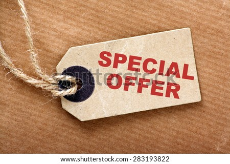 Brown wrapping paper and price or luggage tag with the phrase Special Offer in red text - stock photo