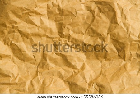 Brown wrinked paper close up texture. - stock photo
