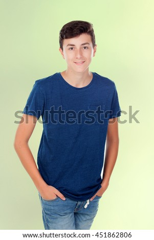 Brown young caucasian boy on green background - stock photo