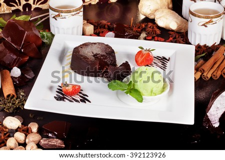 on white ice cream brownie sundae piece of cream cake decorated with ...