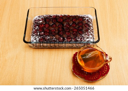 Brownie - chocolate pie with cherry and cup of tea - stock photo