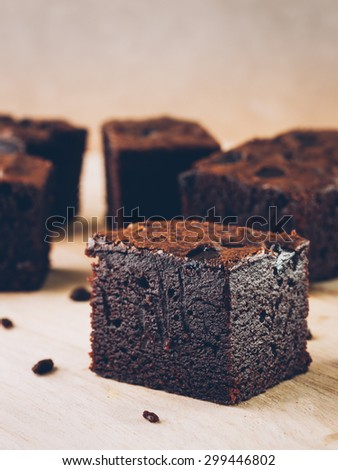 Brownies on a wooden texture, vintage film style - stock photo