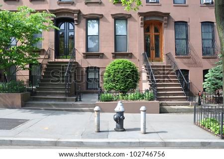 Brownstone Home in Urban Residential Neighborhood in Brooklyn New York - stock photo