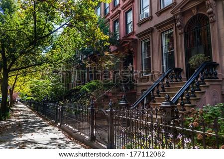 Brownstone Homes along residential Neighborhood sidewalk in Brooklyn New York - stock photo