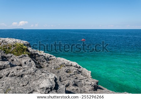 Bruce Peninsula National Park of Canada.  Located at Georgian Bay, a large bay of Lake Huron, on the Bruce Peninsula in Southern Ontario, features a rugged limestone landscape. - stock photo