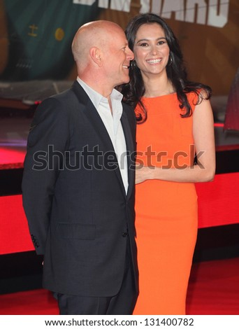 Bruce Willis and Emma Heming arriving for the 'A Good Day to Die Hard' UK Premiere, Empire Leicester Square, London. 07/02/2013 Picture by: Alexandra Glen