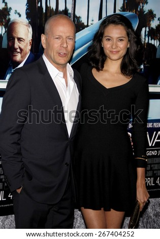 Bruce Willis and Emma Heming at the HBO's 'His Way' Los Angeles Premiere held at the Paramount Studios lot in Hollywood on March 22, 2011. - stock photo