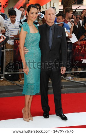 Bruce Willis and wife Emma Heming arriving for the UK Premiere of Red 2, at Empire Leicester Square, London. 22/07/2013 - stock photo