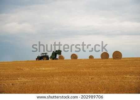 BRUCHHAUSEN, GERMANY 4TH JULY 2014 - Deere & Company, as brand name John Deere, is an American corporation and one of the largest manufacturers of agricultural machinery in the world. - stock photo