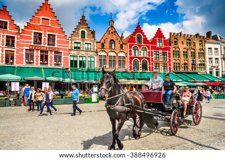 BRUGES, BELGIUM - 7 AUGUST 2014. Horse carriage on Grote Markt square. Belgian city of Bruges (Brugge) is UNESCO world heritage listed for its medieval center. - stock photo