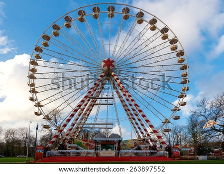 Bruges, Belgium - December 25, 2014: Ferris Wheel in the city park Bruges. One of the most famous tourist attractions in Bruges.
