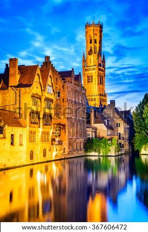 Bruges, Belgium. Image with Rozenhoedkaai in Brugge, Dijver river canal twilight and Belfort (Belfry) tower. - stock photo