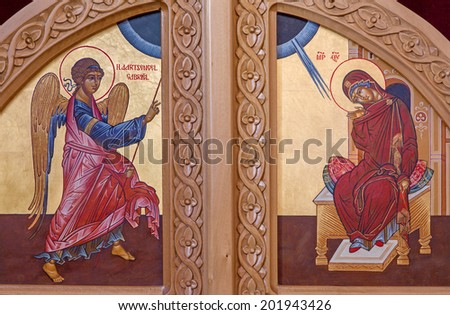 BRUGES, BELGIUM - JUNE 13, 2014: The Annunciation scene on the door to presbytery in st. Constanstine and Helena orthodox church (2007 - 2008).