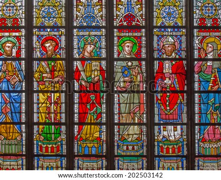 BRUGES, BELGIUM - JUNE 12, 2014: The Saints on the windowpane in St. Salvator's Cathedral (Salvatorskerk) by stained glass artist Samuel Coucke (1833 - 1899).  - stock photo