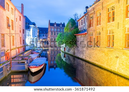 Bruges, Belgium. Night view of city canal and medieval architecture.