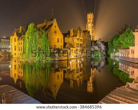 Bruges City, The dock of the Rosary (Rozenhoedkaai) Reflection of Illuminated Old Building Cityscape at night, Belgium - stock photo
