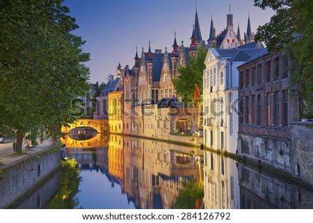 Bruges. Image of Bruges, Belgium during twilight blue hour. - stock photo