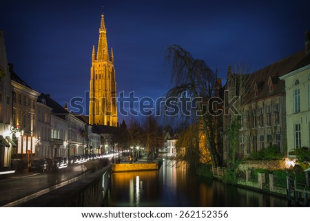 Bruges night scene with canal and church at blue hour, Belgium - stock photo