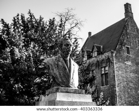BRUGGE, BELGIUM - JANUARY 17, 2016: Ancient city sculptures in Bruges, Belgium. Black-white photo on January 17, 2016 in Brugge - Belgium.