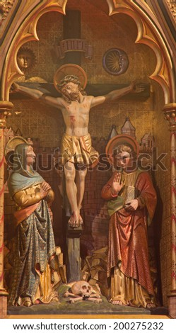 BRUGGE, BELGIUM - JUNE 13, 2014: The Crucifixion. Carving form main altar (19. cent.) in st. Giles (Sint Gilliskerk). - stock photo